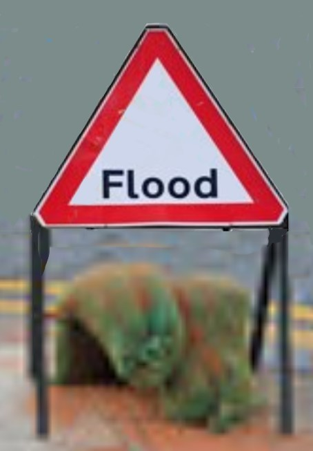 Flood-sign-held-down-with-sandbags